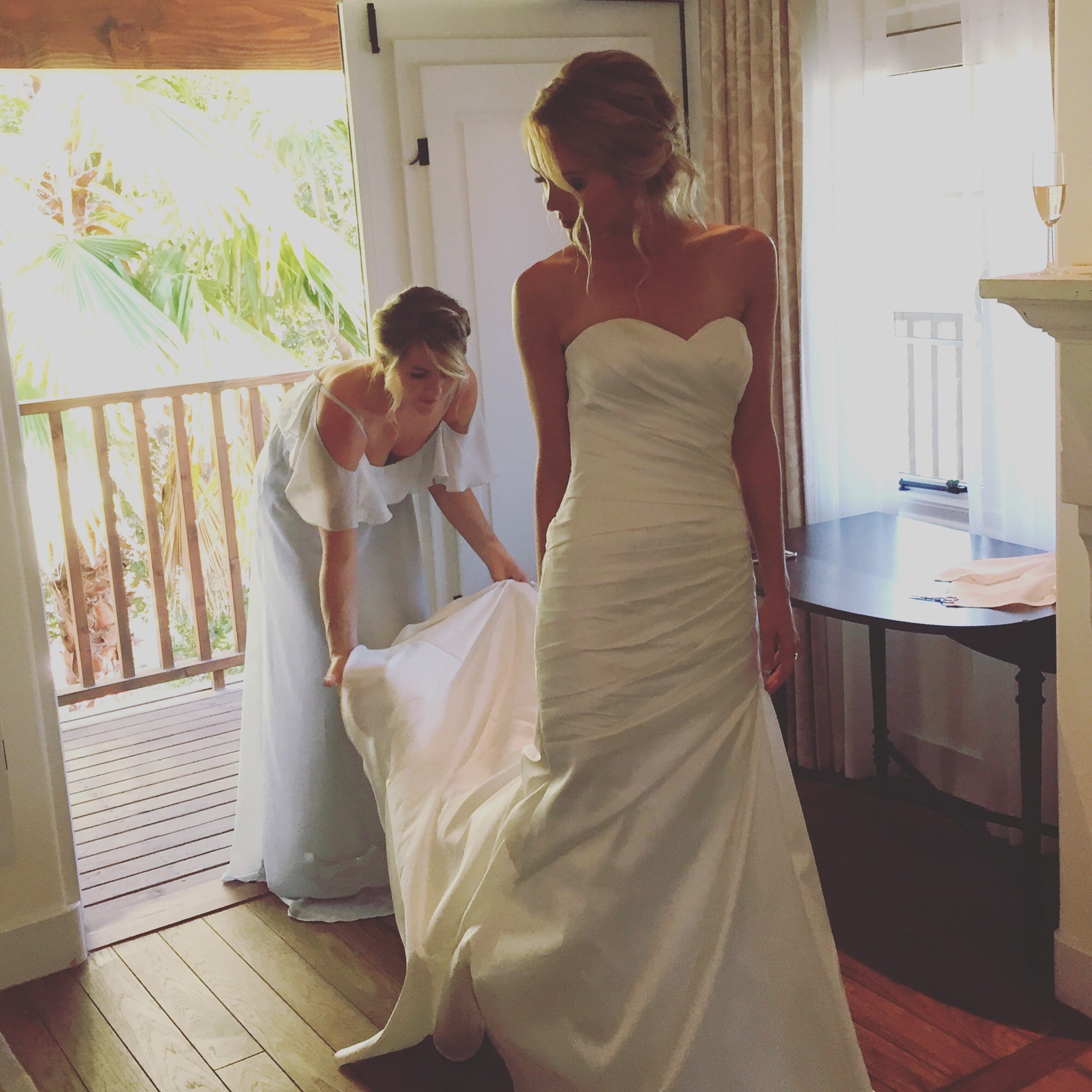 My beautiful girls as maid of honor and bride in the bridal suite pre-ceremony.  I took this photo in a private moment with just the three of us on the cusp of a new and wonderful chapter in our lives.